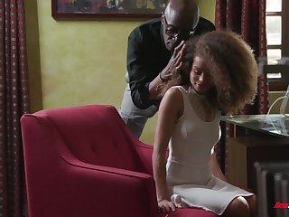 Curly haired petite ebony Cecilia Lion blows and rides a black cock