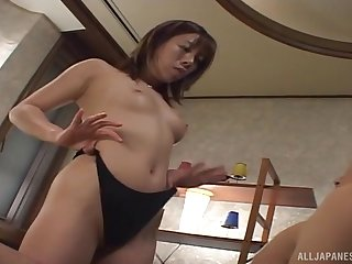 Slender Japanese babe in a bra in a hardcore foot fetish scene
