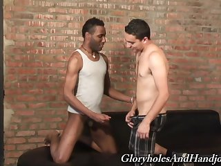 Gay Latino guy sucks and jerks off a well hung black dude in an alley