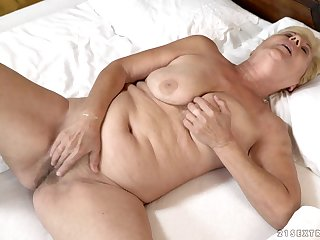 Buxom mature blonde BBW Lili gets her slutty mouth filled with cum