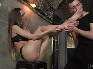 Veronica Clark strokes a cock with her feet before ass pounding