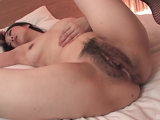 Hairy pussy of Japanese brunette MILF Sayoko Machimura gets creamed