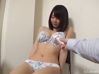Brunette Japanese MILF talked into undressing and masturbating