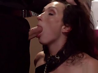Brunette slave sucking in records shop