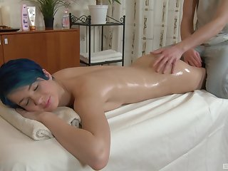 Stunning and oiled Amy Frost enjoys sex on the massage enter