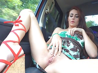 Red head solo model Courtney lifts up her skirt and strokes her pussy