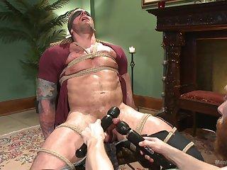 Naked male endures seem like bondage with his master