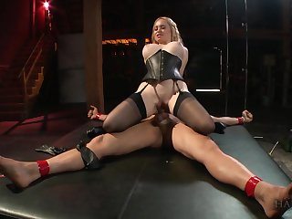 Busty MILF rides her kick off b lure slave coupled with swallows his jizz