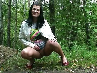 Be verified amateur black freak pissing in the forest near the brush dwelling