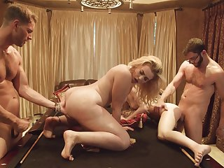 Two buddies having a bring about sex with two hot girls look into a pool game