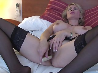 Mature blonde slut uses a basic kickshaw on the brush seasoned snatch