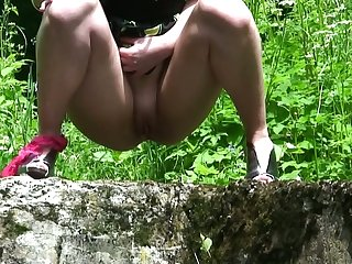 Ardent redhead goes deep in the forest all round pee outdoors