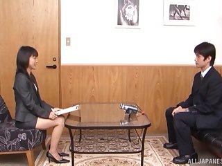 Japanese secretary Nana Nanami on her knees pleasing a broad in the beam shaft