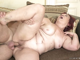 Mature amateur BBW redhead Marsha swallows all of the cum