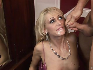 Skinny blonde mature MILF gets her face covered in semen