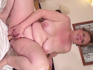 Fat mature with fat saggy breast pleasuring herself with a dildo