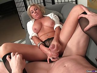 Mature pretty good spreads her legs to tease and strokes a dick
