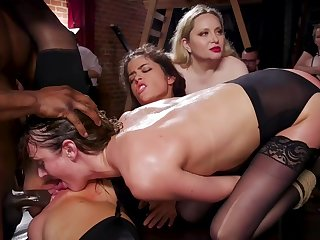 Slaves shagging big coloured cock in party