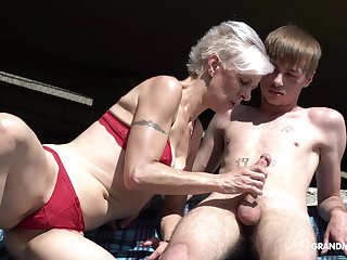Kinky granny relating to thongs sucks a big hard penis of one young guy